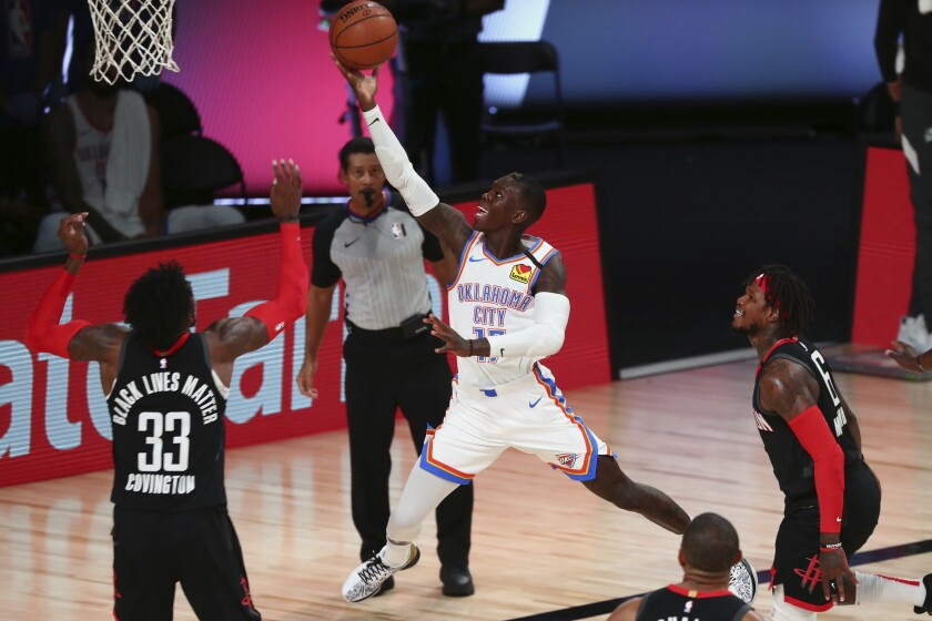 Thunder guard Dennis Schroder drives for a layup against the Rockets in Game 4 on Aug. 24, 2020.