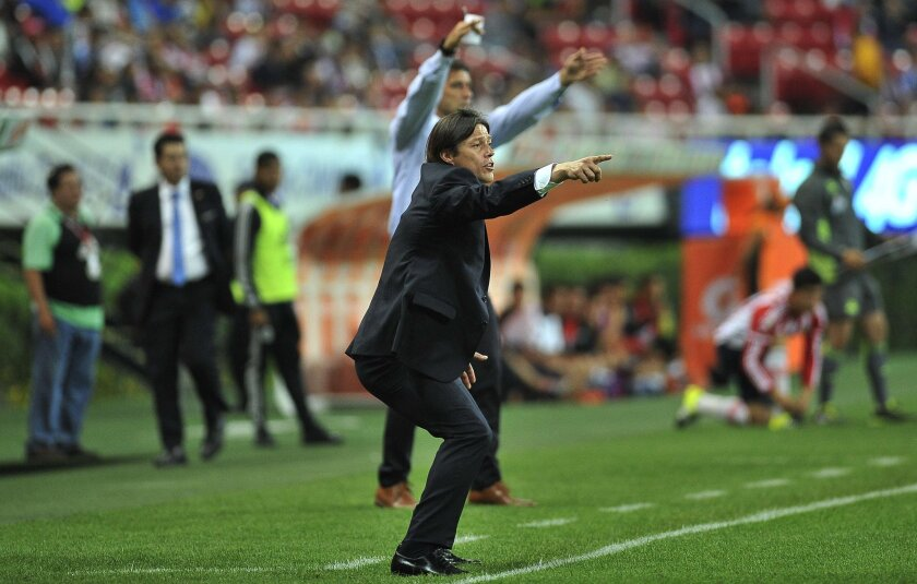 Guadalajara coach Matias Almeyda gesture during their Mexican Apertura2015 tournament football match against Monterrey at Omnilife stadium on 29 September, 2015 in Guadalajara city, Mexico. AFP PHOTO/HECTOR GUERREROHECTOR GUERRERO/AFP/Getty Images ** OUTS - ELSENT, FPG, CM - OUTS * NM, PH, VA if sourced by CT, LA or MoD **