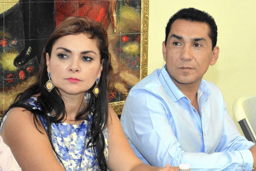 Iguala Mayor Jose Luis Abarca and his wife, Maria de los Angeles Pineda, meet with Guerrero state officials in Chilpancingo, Mexico, in May. He is wanted for questioning in the student disappearances.
