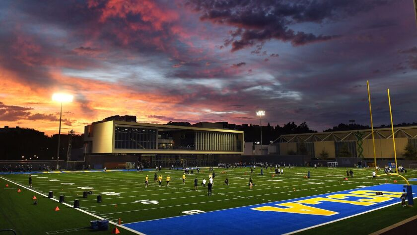 Bruin football players open training camp at the new Spaulding Field on the UCLA campus.