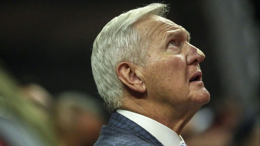Jerry West checks the scoreboard from a courtside seat as the Clippers played the Suns last season.