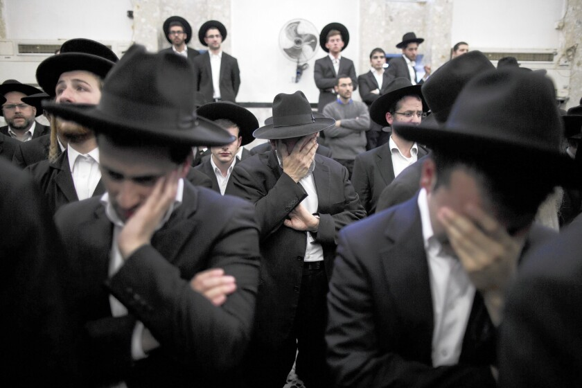Jews mourn for Rabbi Moshe Twersky, who was killed in the Har Nof synagogue attack in Jerusalem.