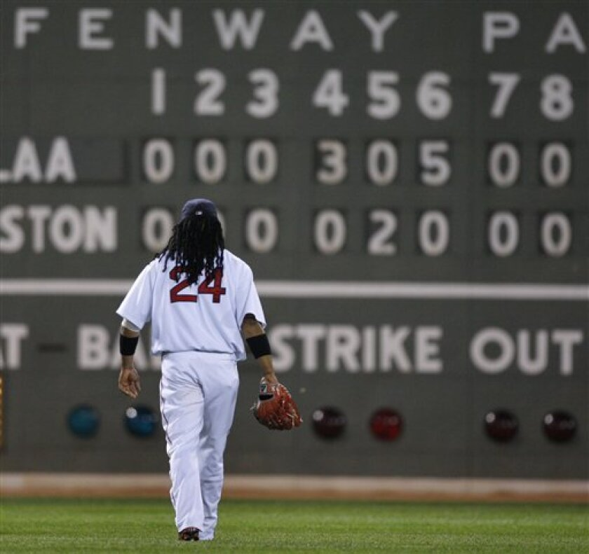 Boston Red Sox's Manny Ramirez takes left field in the ninth inning of their baseball game against the Los Angeles Angels at Fenway Park in Boston, Wednesday, July 30, 2008. The Angels beat the Red Sox 9-2. (AP Photo/Elise Amendola)