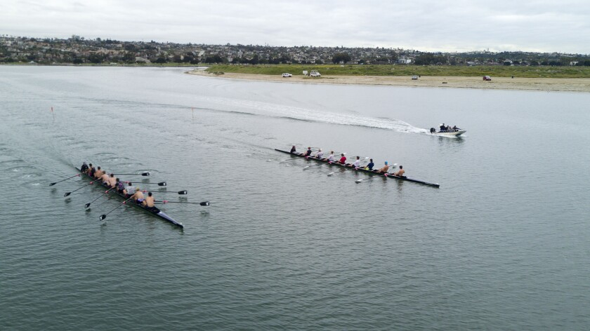Crew teams practice early Thursday morning for this weekend's Crew Classic rowing regatta on Mission Bay.