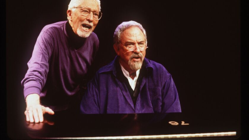 Harvey Schmidt, right, performs with director Tom Jones at the Laguna Playhouse in 2000.