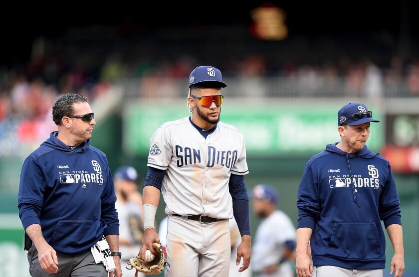 Fernando Tatis Jr. walks off the field in the 10th inning after injuring his hamstring.