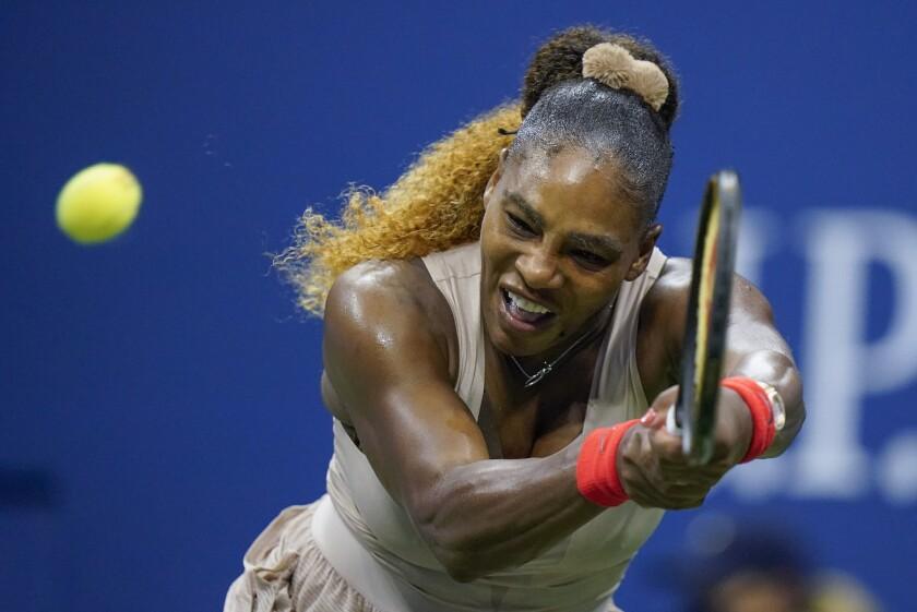 Serena Williams returns a shot to Victoria Azarenka in the U.S. Open semifinals.