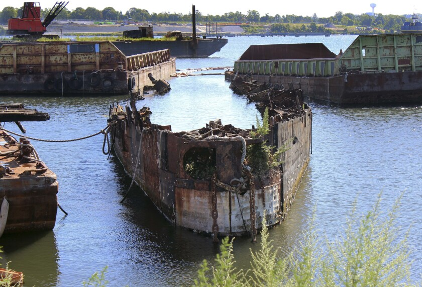FILE - In this Aug. 22, 2016 photo, the remnants of a Cold War-era Russian submarine, once used as a floating museum until it sank in 2007, sits rusting in the Providence river in Providence, R.I. The remains of the submarine caught fire, Tuesday, March 9, 2021, as workers were using a blow torch to cut it up for scrap. (AP Photo/Jennifer McDermott, File)