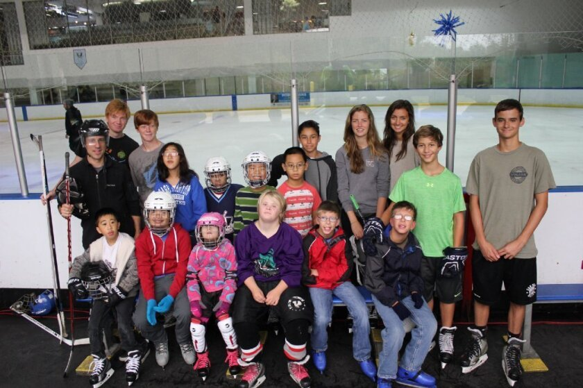 The San Diego Chill ice hockey program was founded by Carmel Valley's Isaiah Granet, right in green. Courtesy photo