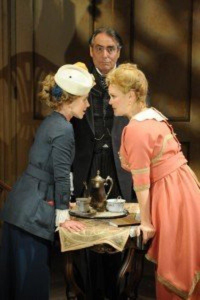 Cecily (Rachael VanWormer) and Gwendolen (Jacque Wilke) with the butler (David Cochran Heath), at Cygnet Theatre.