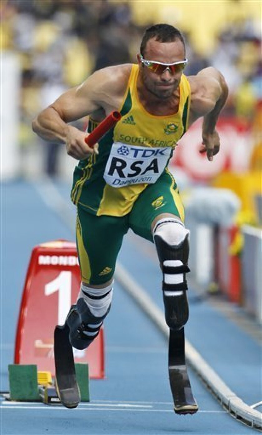 FILE - The Sept. 1, 2011 file photo shows South Africa's Oscar Pistorius competing in a qualification round for the Men's 4x400m Relay at the World Athletics Championships in Daegu, South Korea. South Africa said Friday, Sept. 2, 2011 Oscar Pistorius has been left off 4x400-meter relay team for Friday's final. (AP Photo/Anja Niedringhaus)
