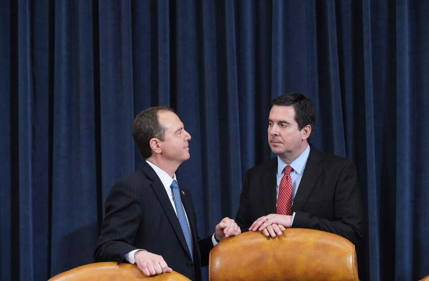 Rep. Adam Schiff, left, and Rep. Devin Nunes chat before taking their seats during a House Intelligence Committee hearing on Russian actions during the 2016 election campaign on March 20, 2017.