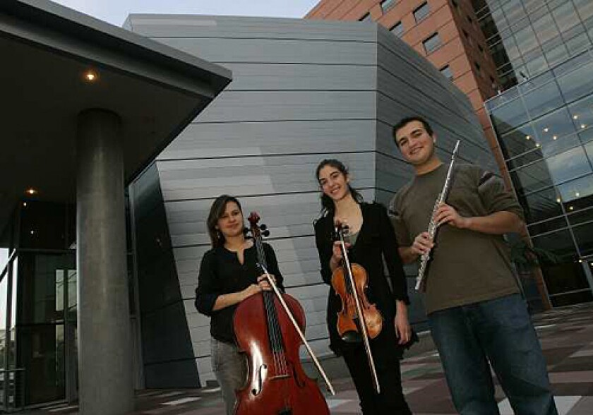 IMMERSED IN MUSIC: Indira Rahmatulla, left, of Ankara, Turkey, Elicia Silverstein of Short Hills, N.J., and Francesco Camuglia of Las Vegas are students at Colburn.