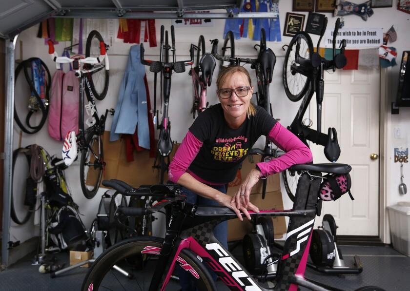 Michellie Jones, an Olympic silver medalist in 2000 and now head coach of UC San Diego's collegiate program, will race in Sunday's San Diego International Triathlon.