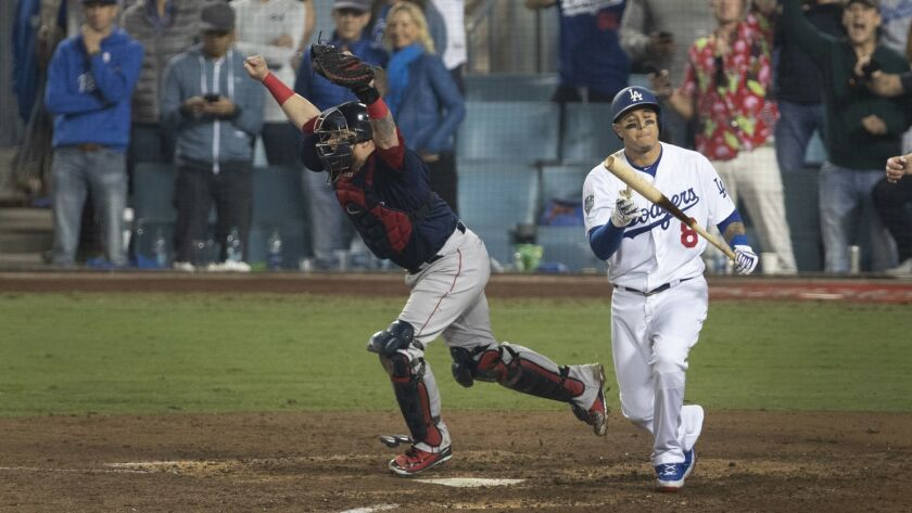 LOS ANGELES, CALIF. -- SUNDAY, OCTOBER 28, 2018: Dodgers Manny Machado strikes out as Red Sox catche