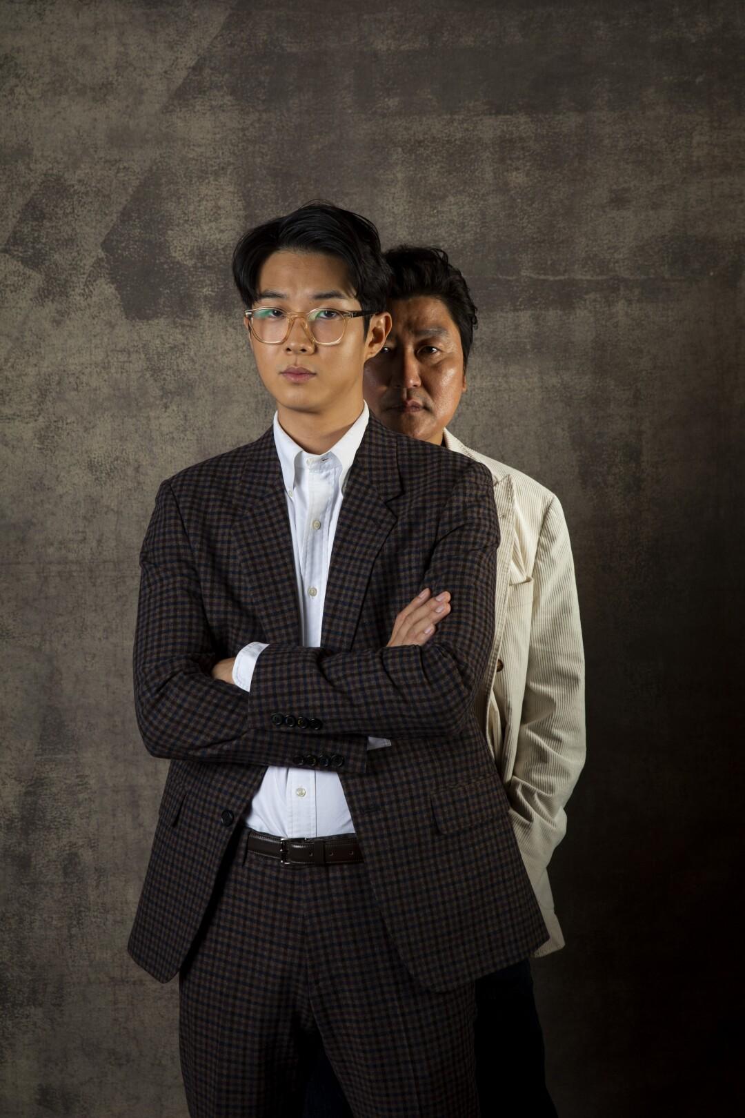 Choi Woo Shik, front, and Song Kang Ho