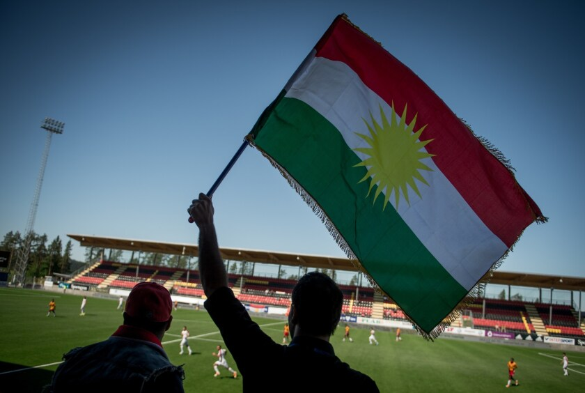 Supporter waves Kurdish flag at soccer game in Sweden in June.