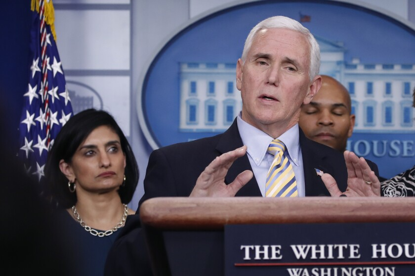 Vice President Mike Pence speaks during a briefing on coronavirus in the Brady press briefing room at the White House, Saturday, March 14, 2020, in Washington, as Administrator of the Centers for Medicare and Medicaid Services Seema Verma, left, listens. (AP Photo/Alex Brandon)