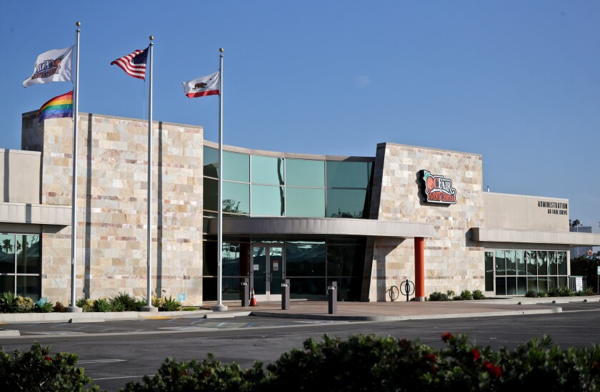Flags fly outside the O.C. Fair & Event Center administration building in Costa Mesa on Thursday.