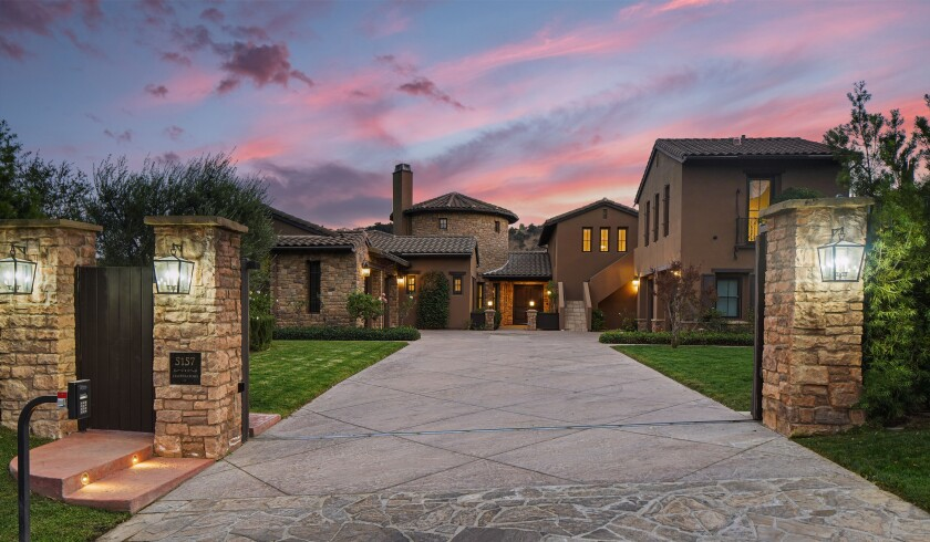 The Tuscan-style retreat has five bedrooms, six bathrooms, a double-height dining room and a professional recording studio.