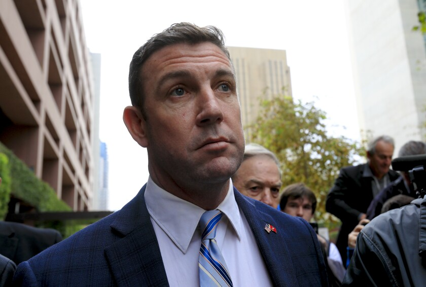Rep. Duncan Hunter, photographed here outside Federal Court in downtown San Diego after pleading guilty in December, is expected to still receive the congressional portion of his pension.