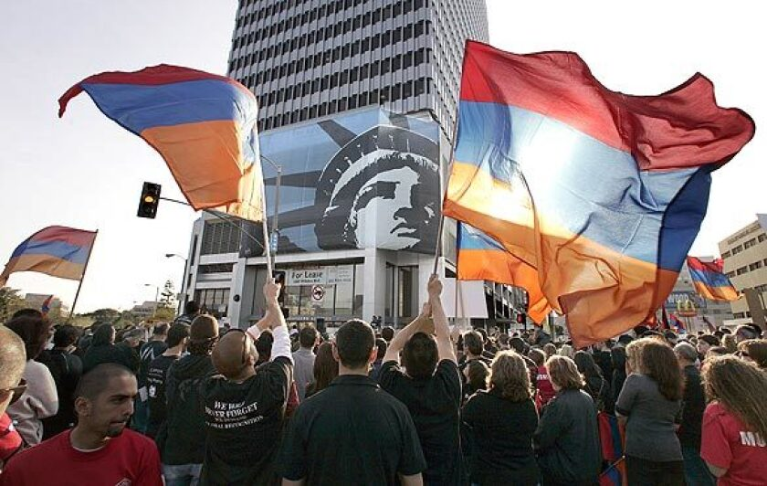 Protesters wave the Armenian flag during an April 2009 demonstration outside the Turkish Consulate on Wilshire Boulevard, calling for an end to Turkey's denials of an Armenian genocide.