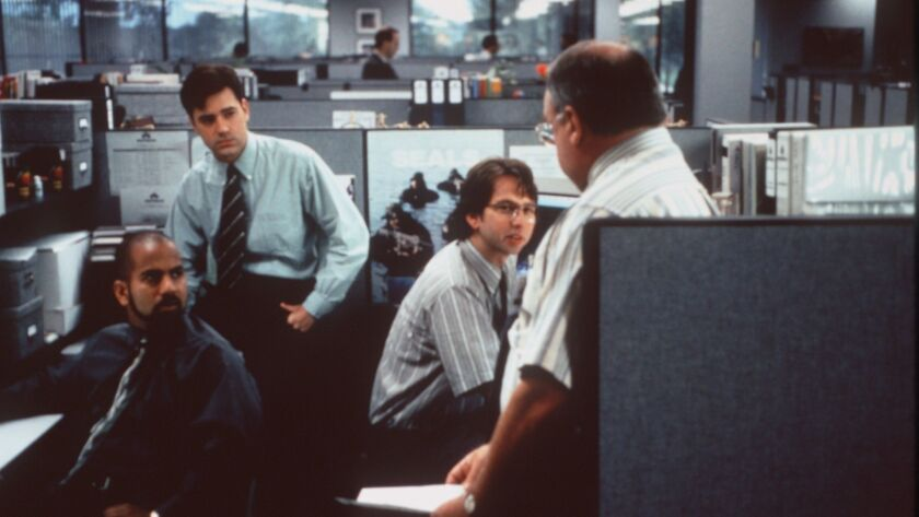 """Ajay Naidu, Ron Livingston, David Herman and Richard Riehle reviews their options when they suspect they might be """"downsized"""" in """"Office Space."""""""