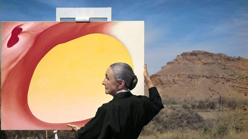 "Tony Vaccaro, Georgia O'Keefe with ""Pelvis Series, Red with Yellow"" and the desert, 1960. Georgia O'"