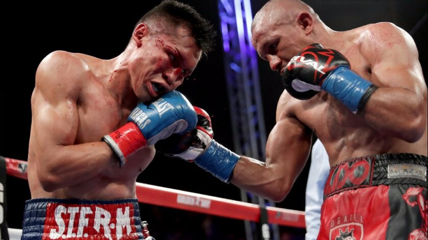 Orlando Salido hits Francisco Vargas, left, with a right hand during their WBC super-featherweight title bout on June 4.