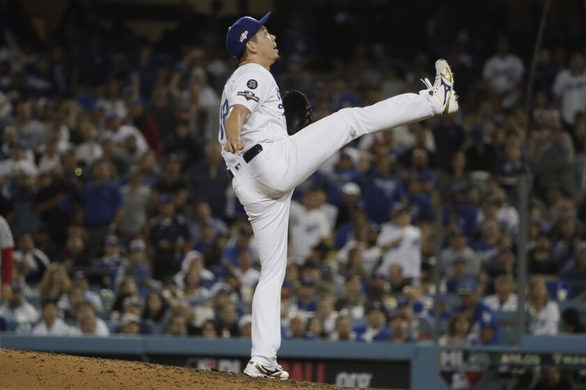 Dodgers reliever Kenta Maeda reacts to a popup during the seventh inning of a 6-0 win over the Nationals in Game 1 of the National League Division Series on Thursday.