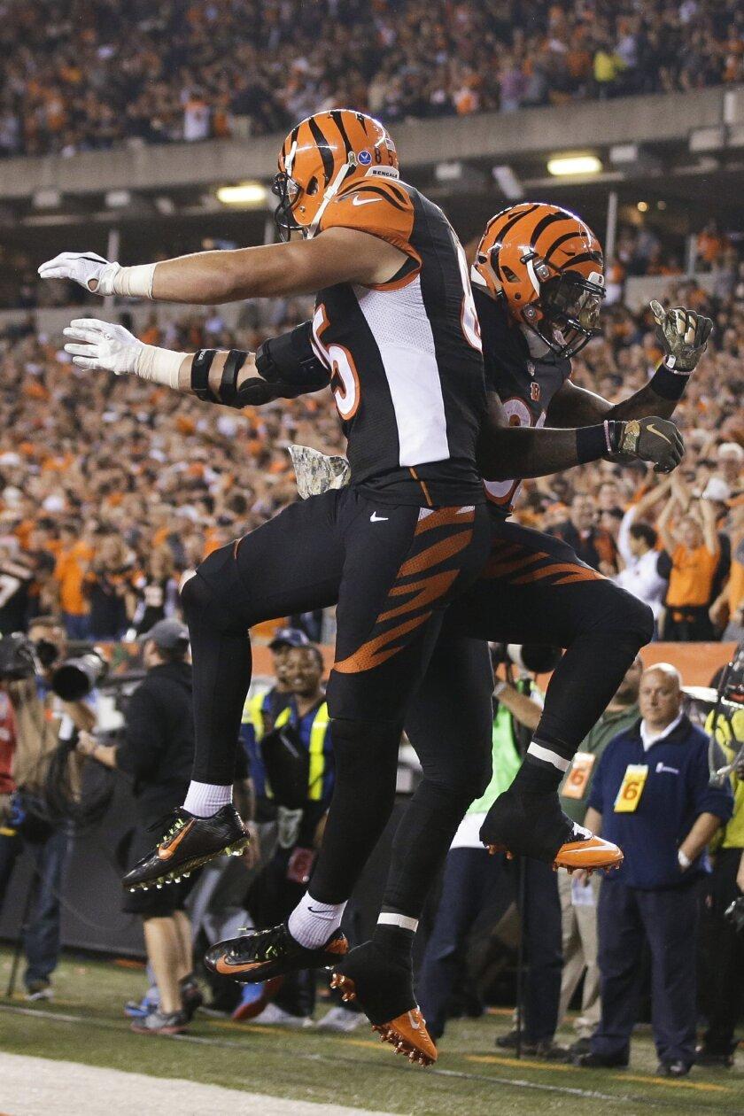 Cincinnati Bengals tight end Tyler Eifert, left, celebrates with running back Jeremy Hill after Eifert's touchdown during the second half of an NFL football game against the Cleveland Browns, Thursday, Nov. 5, 2015, in Cincinnati. (AP Photo/Darron Cummings)