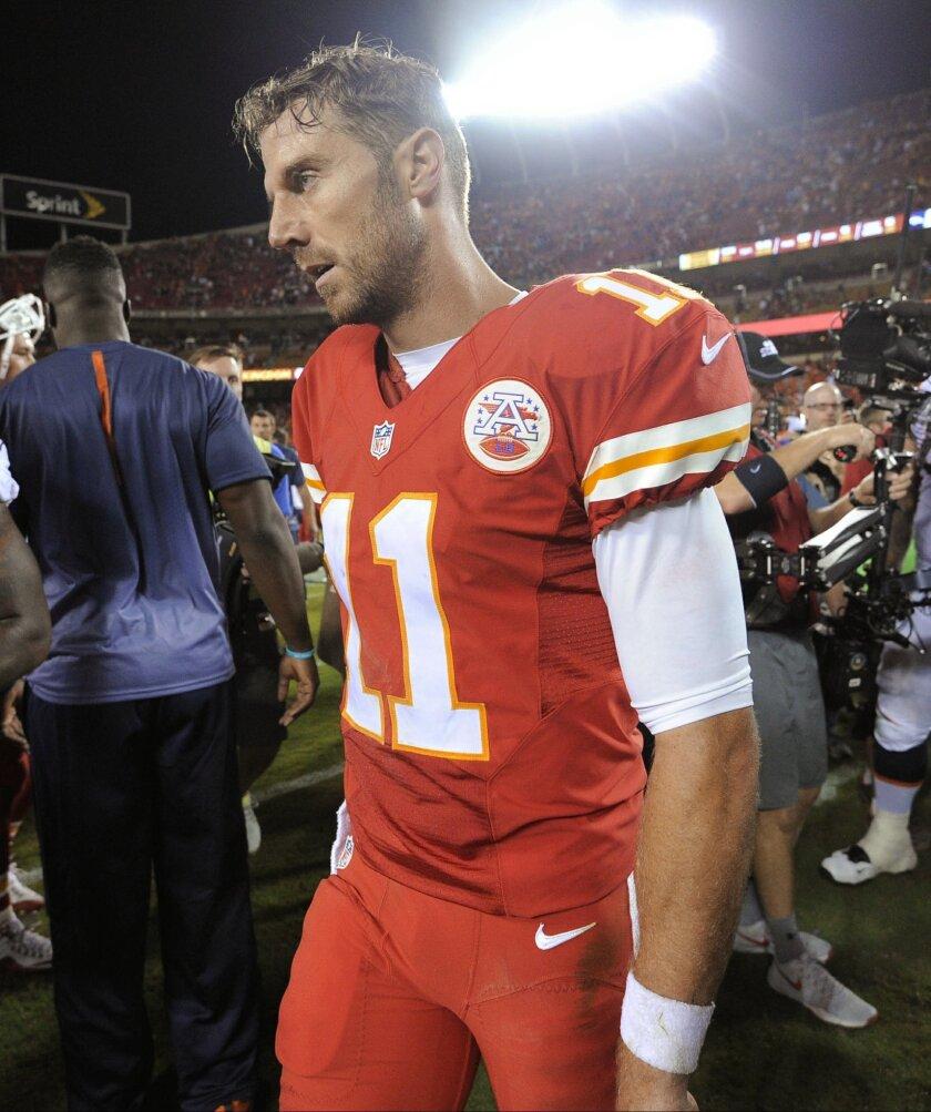 Kansas City Chiefs quarterback Alex Smith walks off the field following the Chiefs' NFL football game against the Denver Broncos in Kansas City, Mo., Thursday, Sept. 17, 2015. The Broncos won 31-24. (AP Photo/Ed Zurga)