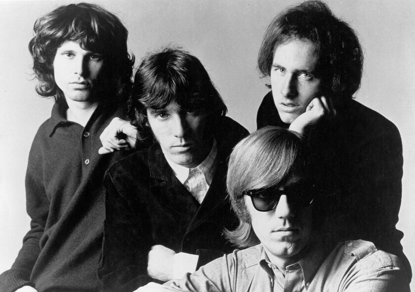"Jim Morrison, Ray Manzarek, Robbie Krieger and John Densmore of ""The Doors"" pose for a promotional photos circa 1966."