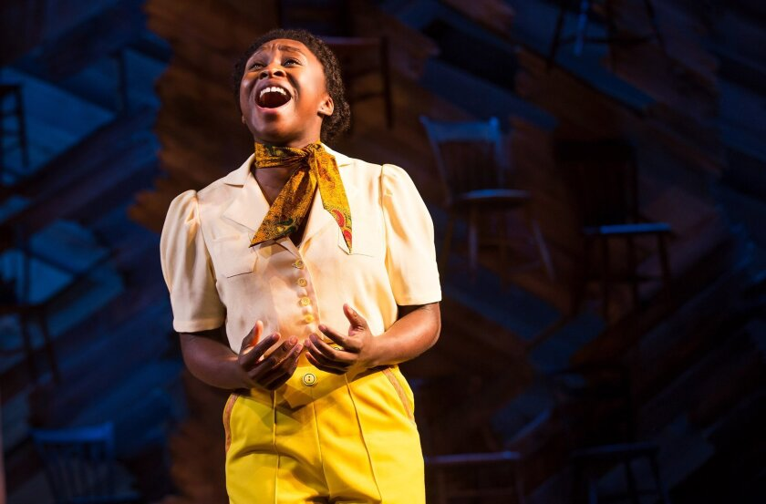 "Cynthia Erivo on stage as Celie in the musical adaptation of ""The Color Purple."""