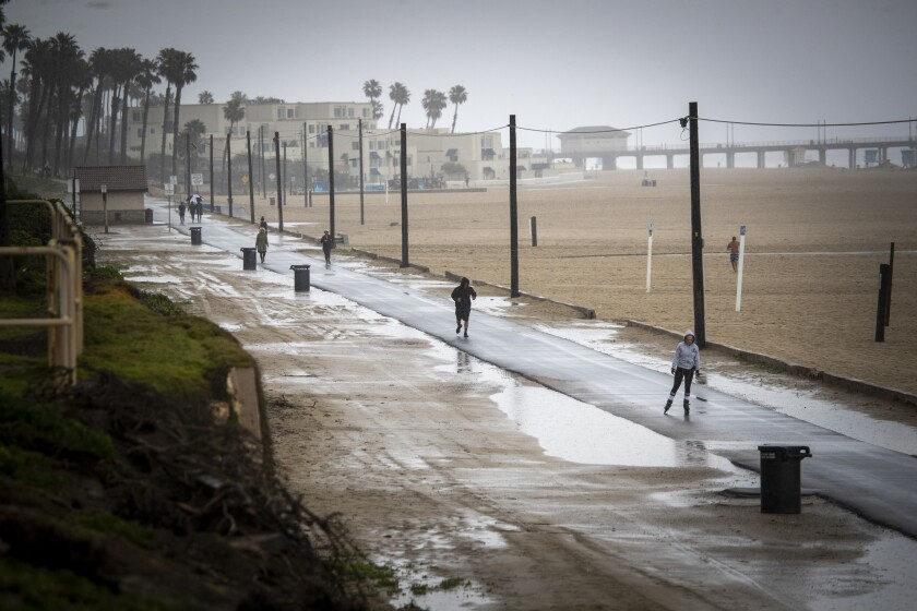 People exercise on a bike path in Huntington Beach on Friday.