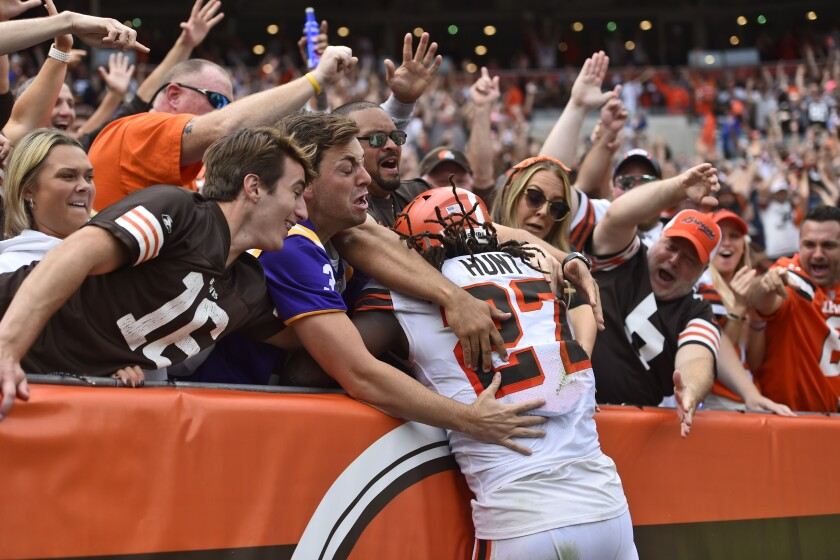 Cleveland Browns running back Kareem Hunt (27) is mobbed by fans after he scored a 29-yard touchdown during the second half of an NFL football game against the Chicago Bears, Sunday, Sept. 26, 2021, in Cleveland. (AP Photo/David Richard)
