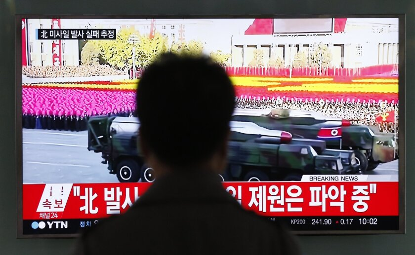 "A man watches a TV news program reporting about North Korea's missiles at the Seoul Train Station in Seoul, South Korea, Tuesday, May 31, 2016. A North Korean missile launch likely failed on Tuesday, according to South Korea's military, the latest in a string of high-profile failures that tempers somewhat recent worries that Pyongyang was pushing quickly toward its goal of a nuclear-tipped missile that can reach America's mainland. The letters read on top left, ""North Korean missile launch likely failed."" (AP Photo/Lee Jin-man)"