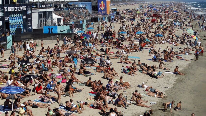 Thousands will crowd the shoreline Saturday through Aug. 6 for the U.S. Open of Surfing in Huntington Beach, as they did here in 2015.