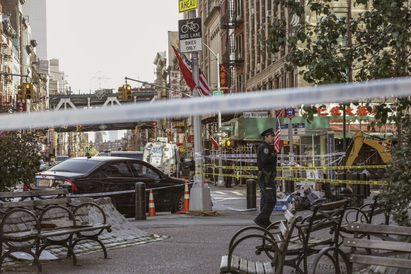 A police officer stands at the scene of the attack in Manhattan's Chinatown.
