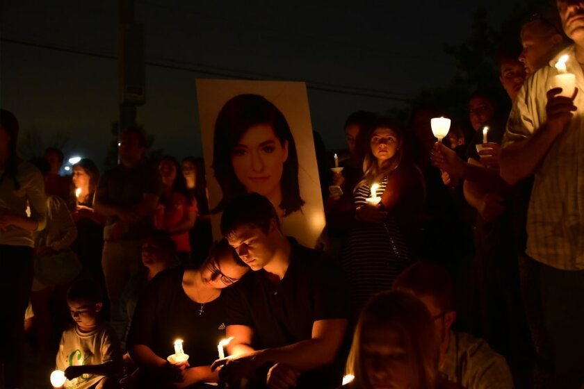 Friends mourn the loss of Christina Grimmie during a vigil last week in New Jersey.