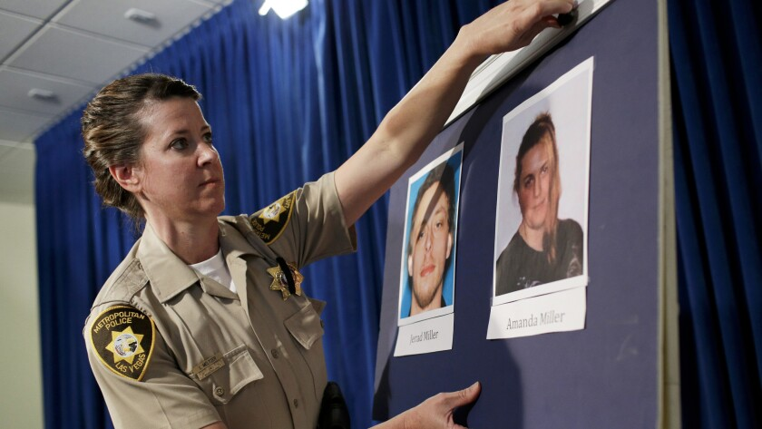 Las Vegas Metropolitan Police Department Officer Laura Meltzer posts photos ofJerad and Amanda Miller before a news conference on June 9, 2014.