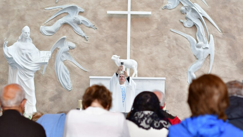 Mass taking place in the Apparition Chapel in Knock, in the west of Ireland, the wall behind given a