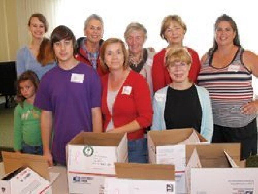 Volunteers at last year's RSF Garden Club military care package event: Front: Hannah Johnson, Ari Jam, Mary Jam, Cynthia Harrison; back: Hayley Cunningham, Ginger Bord, Shirley Corless, Pat Merino, Suzanne Johnson/ Photo/Jon Clark