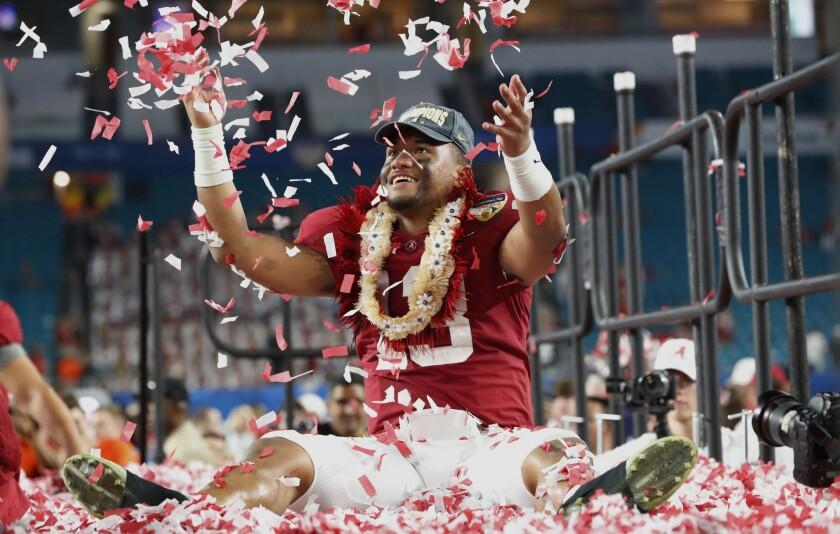 Alabama quarterback Tua Tagovailoa throws confetti in the air after winning the Orange Bowl against Oklahoma on Dec. 30, 2018 in Miami Gardens, Fla.