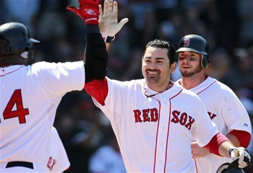 Boston Red Sox's Adrian Gonzalez, center, celebrates his two-run home run that drove in Jarrod Saltalamacchia, right, in the fourth inning of a baseball game against the Oakland Athletics, Sunday, June 5, 2011, in Boston. (AP Photo/Michael Dwyer)