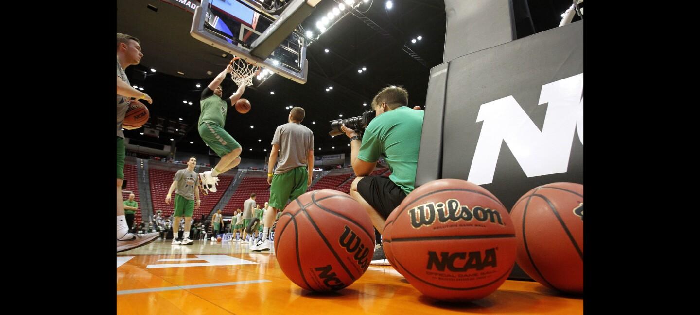 Marshall University's Milan Mijovic dunks the ball during Marshall's practice.