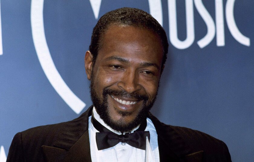 """FILE - In this Jan. 17, 1983, file photo, singer-songwriter Marvin Gaye, winner of Favorite Soul/R&B Single, """"Sexual Healing,"""" attends the American Music Awards in Los Angeles. Presentations and performances from the B-52s, Jennifer Hudson, Marcus Mumford and Sister Sledge will be featured at the S"""
