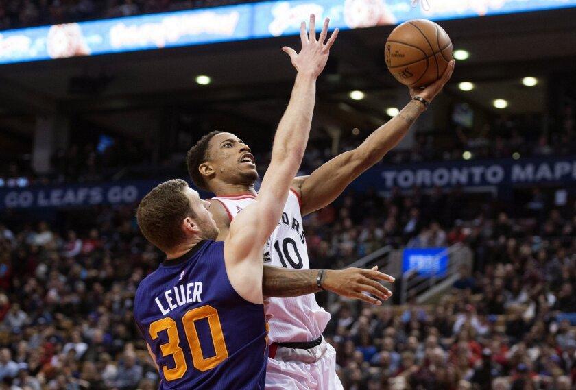 Toronto Raptors' DeMar DeRozan, right, drives past Phoenix Suns' Jon Leuer during the first half of an NBA basketball game in Toronto on Sunday, Nov. 29, 2015. (Darren Calabrese/The Canadian Press via AP) MANDATORY CREDIT