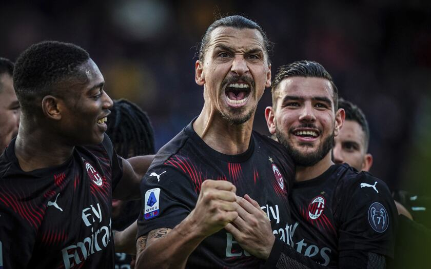 Milan's Zlatan Ibrahimovic celebrates with teammates after scoring his side's second goal during an Italian Serie A soccer match between Cagliari and Milan in Cagliari, Saturday, Jan. 11, 2020. (Spada(/LaPresse via AP)
