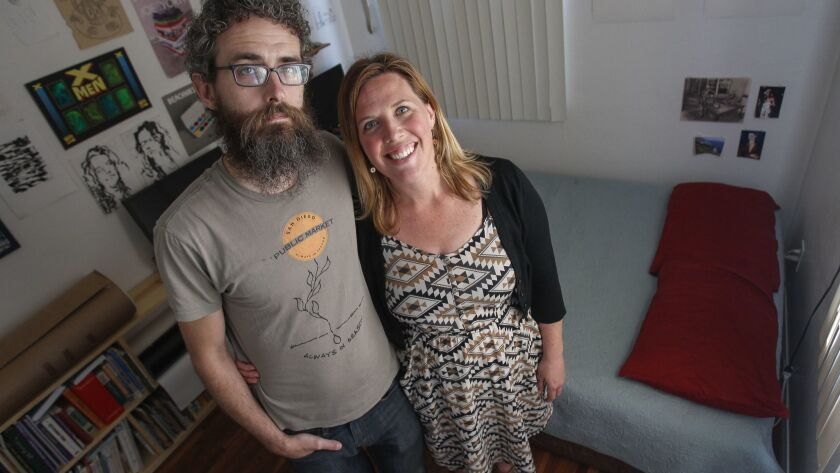 SAN DIEGO, April 26, 2018   Blair Overstreet and her husband Matt Dunn stand in their spare bedroom